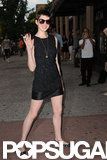 Anne Hathaway gave a wave on her way into the Shut Up & Play the Hits screening in NYC.