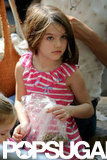 Suri Cruise helped feed the animals at the zoo.