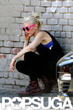 Gwen Stefani let a purple bra show under her black tank top.
