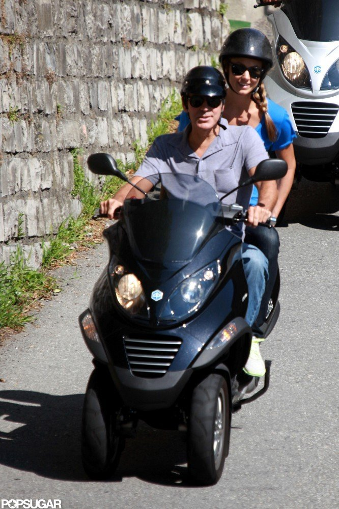 Both George Clooney and Stacy Keibler donned black sunglasses and helmets for the ride.