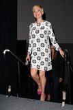 Michelle Williams looked lovely in a patterned white dress with pink heels.