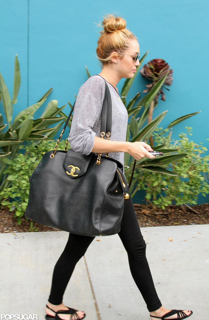 Miley Cyrus wore her hair in a high bun for Pilates in LA.