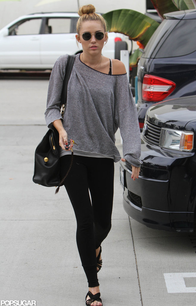 Miley Cyrus wore circular sunglasses on her way into pilates.