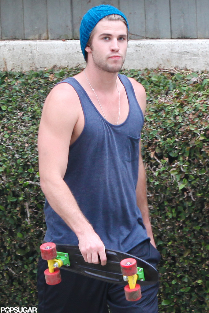 Liam Hemsworth wore a bright blue hat and carried his skateboard in LA.