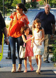 Katie Holmes put her arm around Suri Cruise at an outing at Chelsea Piers.