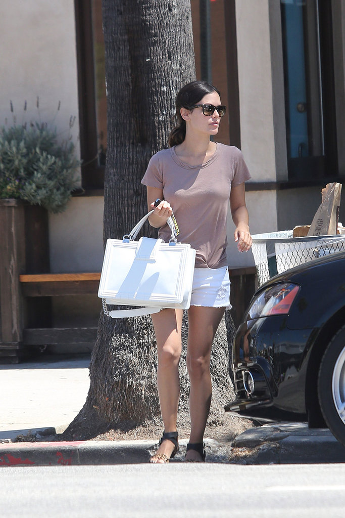 Rachel Bilson kept it pulled-together off-duty in a pair of white cutoffs and a coordinating Chanel tote.