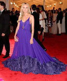 She had a serious entrance at this year's Met Gala in a showstopping purple Prada gown.