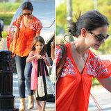 Katie Holmes's bold tunic top would look just as awesome at the beach as it would around the city. Get the look.