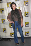 Milla Jovovich opted for an ultracasual outfit, wearing flared jeans and a soft scarf on top.