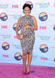 Tamera Mowry showed off her sweet baby bump in printed sheath.