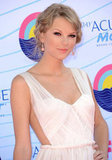 Taylor Swift finished off her look with coral earrings from Lorraine Schwartz.