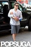 Mike Comrie held baby Luca Comrie as they arrived in NYC.