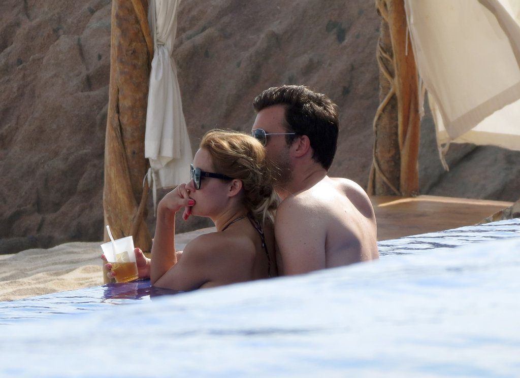Lauren Conrad showed PDA poolside with William Tell while on a Cabo getaway in July.