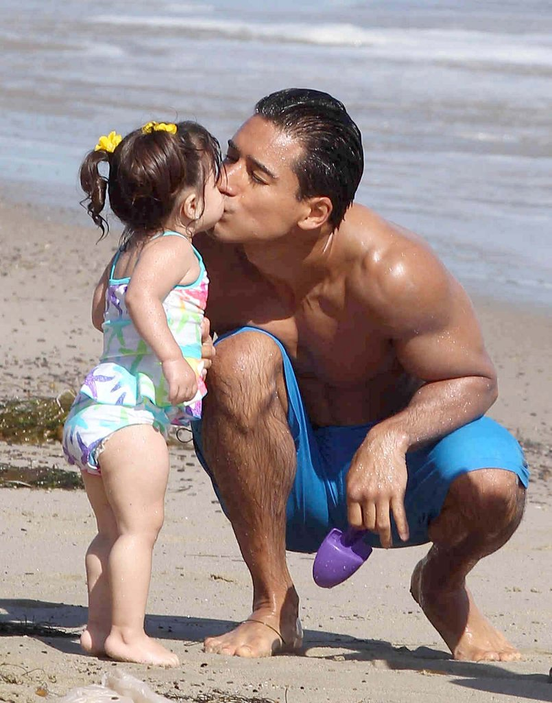 Mario Lopez kissed his daughter, Gia Lopez, at an LA beach.