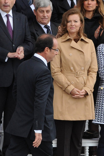 Valérie Trierweiler watched her partner, French president François Hollande, walk before the Bastille Day military parade began.