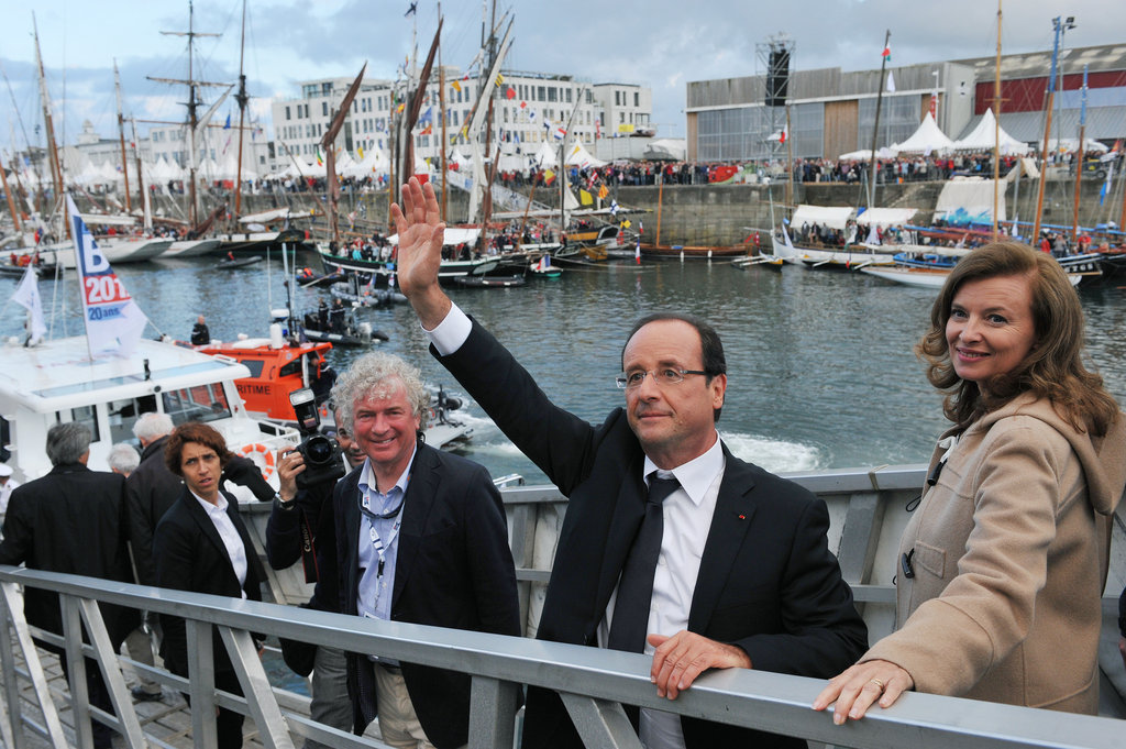 French president François Hollande waved beside partner Valérie Trierweiler during the shipping festival, Tonnerres de Brest, in Western France.
