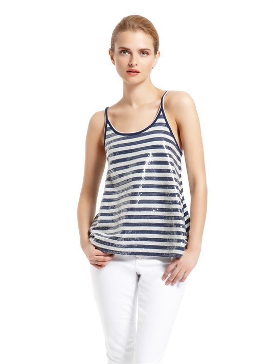 This sequined tank is instant glam for styling up white jeans in a hurry.  DKNY Jeans Stripe Sequin Swing Tank ($59)