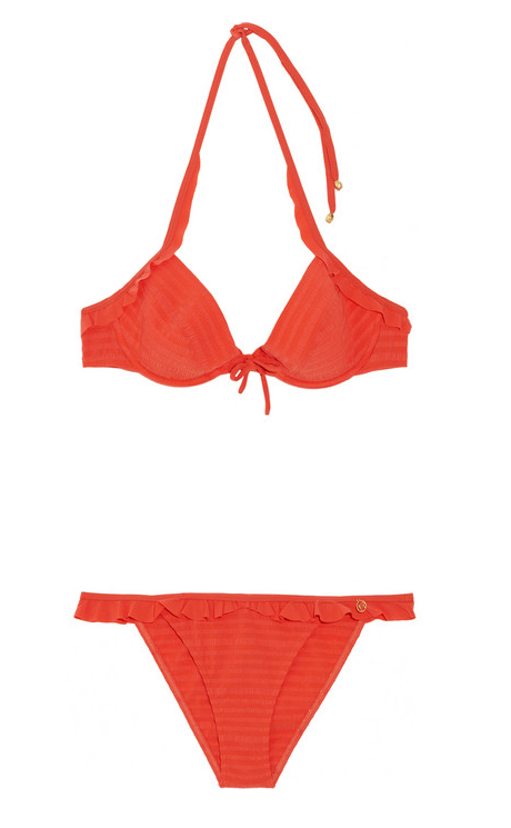 A feminine ruffle bikini in a bright orange hue — in case we have time to make it to the beach.  Nina Ricci Ruffle Trim Bikini ($146, originally $365)