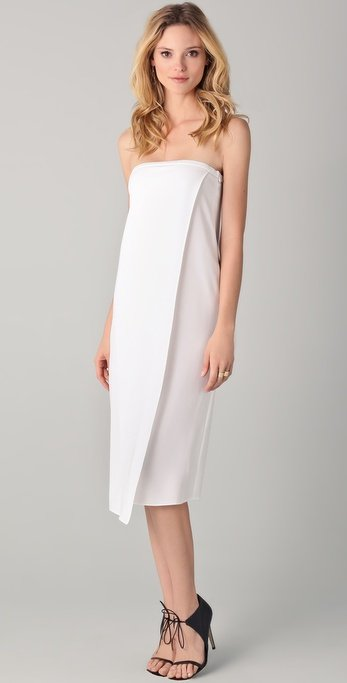 We'd wear this LWD with flats for a day filled with swimwear appointments and shows.  Tibi Strapless Dress ($210, originally $420)