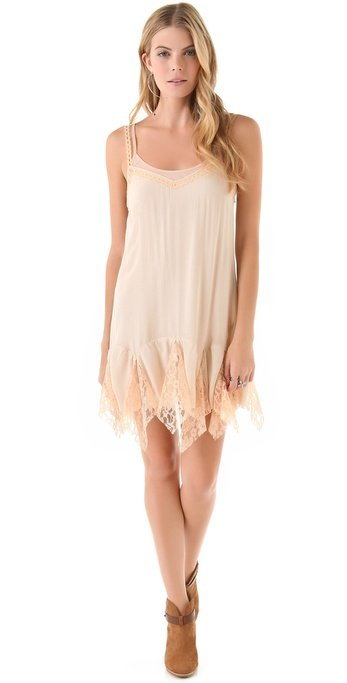 This little slip dress will keep you cool and styled with its dreamy, boho-femme flair.  Free People Godet Slip Dress ($88)