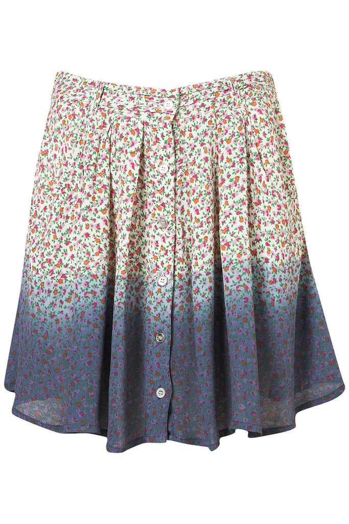 Don't underestimate the ability of this little mini to transform your everyday look — or help keep you cool.  Topshop Floral Button Through Skirt ($56)
