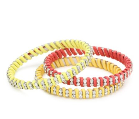 Amping up your accessory routine is a surefire way to lend your outfit a little oomph without adding any heat-inducing layers.  Beyond Rings Faux Suede and Cubic Zirconia Set of Three Yellow Bangle Bracelets ($60)