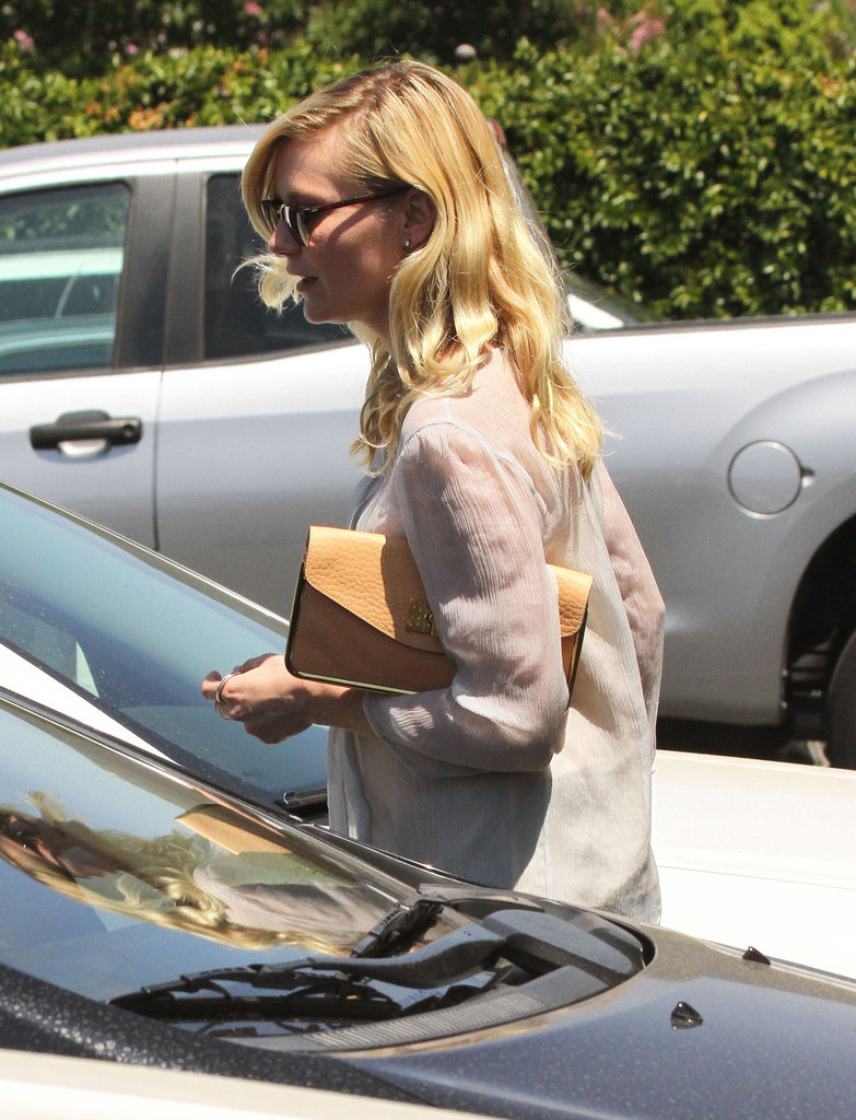 Kirsten Dunst wore her blond locks down while running errands.