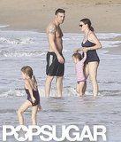 A shirtless Ben Affleck watched Violet in the water while Jennifer Garner held on to Seraphina in Puerto Rico.