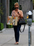 Lauren Conrad carried her new purchase as she walked in West Hollywood.
