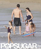 Ben Affleck was shirtless while Jennifer Garner wore a dark blue swimsuit to play with daughters Violet and Seraphina in the ocean in Puerto Rico.