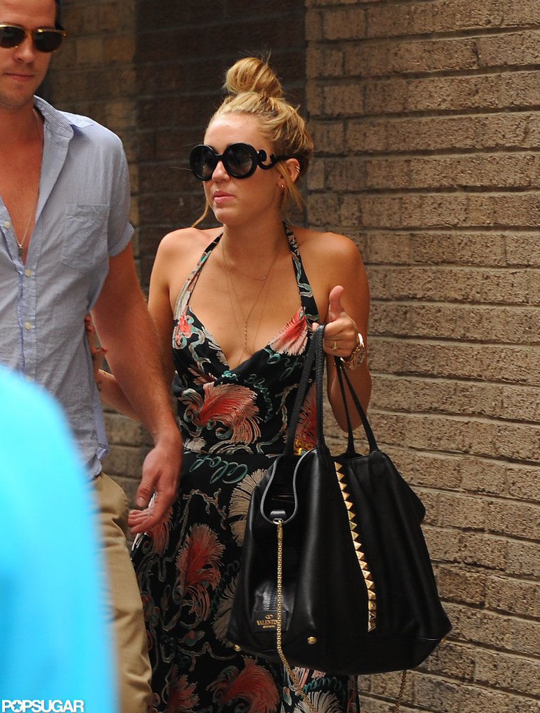 Miley Cyrus stayed close to fiancé Liam Hemsworth.