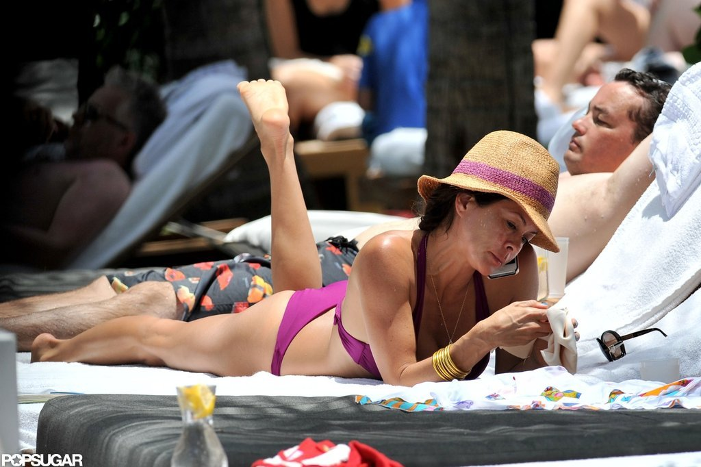 Brooke Burke chatted on the phone in her bikini.