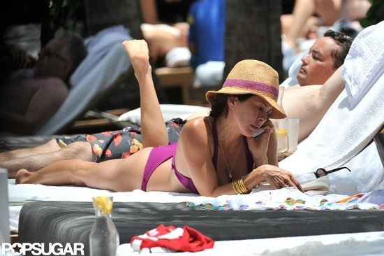 Brooke Burke Lounges in a Bright Bikini With Shirtless David Charvet