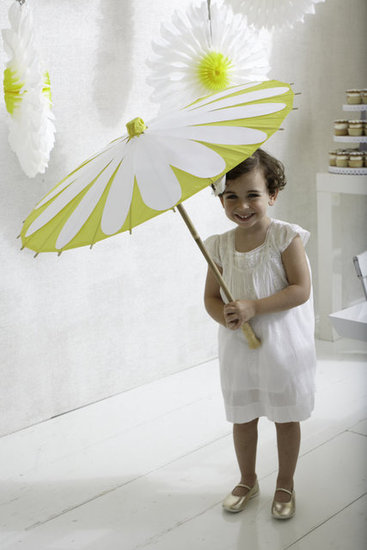 Is there anything sweeter than a lil girl and her parasol on a sunny day? These daisy-themed sunshades will be available through the sale.  Source: Photos by Bryan Gardner. Courtesy of Martha Stewart