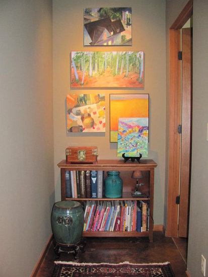 Don't just hang a picture. Fill the wall with artwork to make an impact with color.