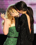 Sandra Bullock planted a kiss on Scarlett Johansson during the June 2010 MTV Movie Awards in LA.