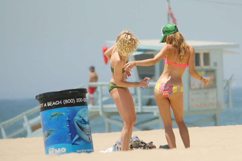 AnnaLynne McCord's sister sprayed her with sunscreen on the beach in LA.