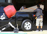 Shia LaBeouf tied down the lumber in the back of his truck.