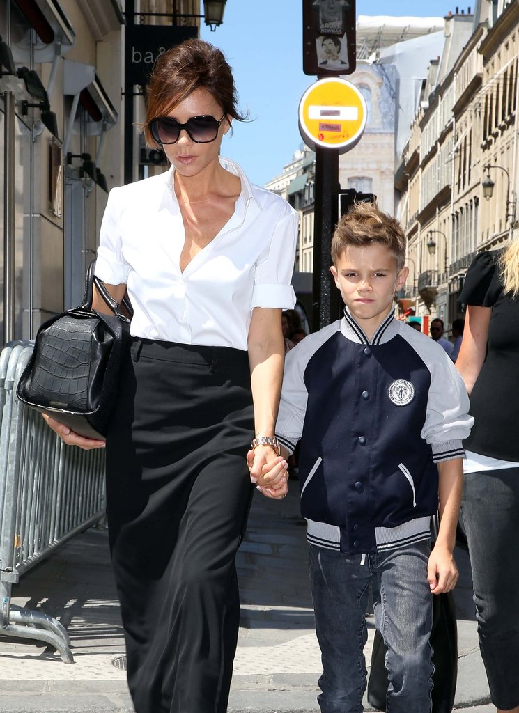 The always-posh Victoria Beckham held hands with son Romeo Beckham while shopping in Paris.