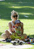 Gwen spent time with her kids at the park wearing these Stella McCartney black round sunglasses ($225).