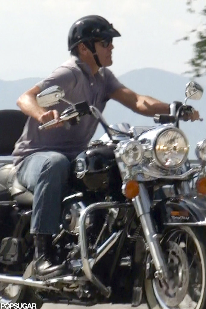 George Clooney rode his motorcycle.