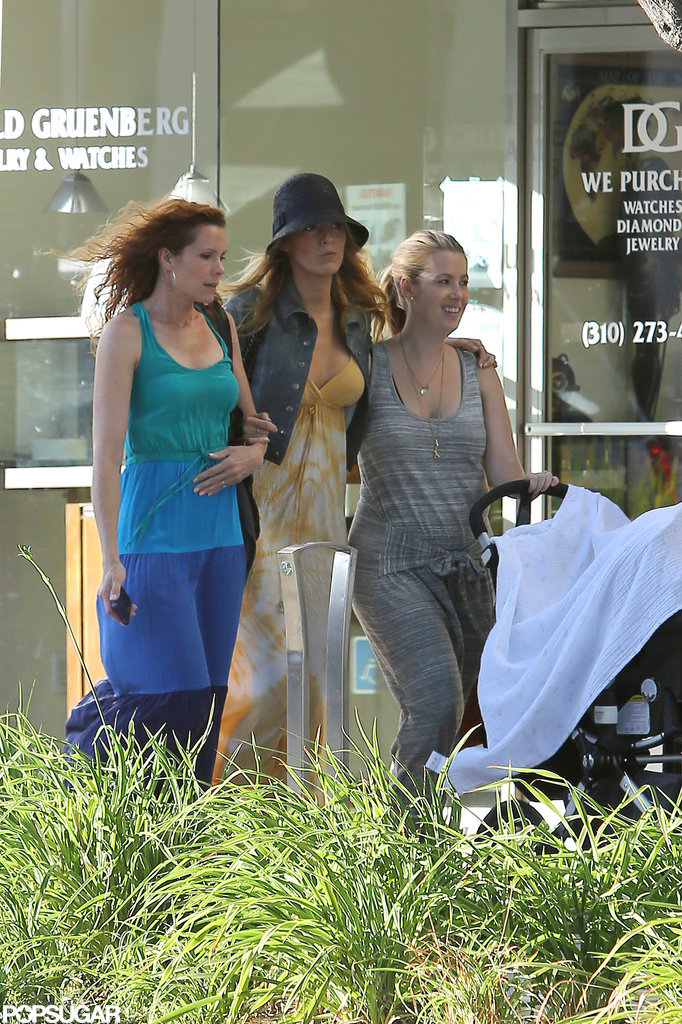 Blake Lively linked arms with her sister.