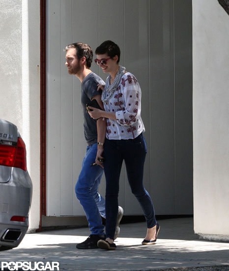 Anne Hathaway and Adam Shulman laughed together.