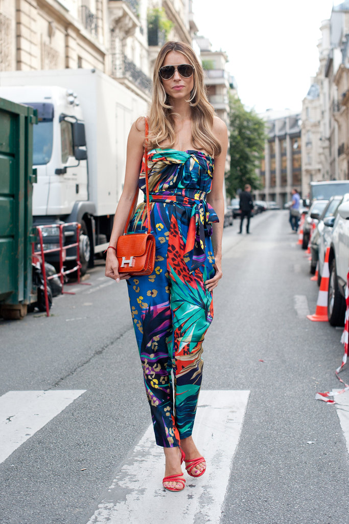 High-impact in the best sense — look to a bright jumpsuit, then echo your favorite complementary colors with your bag and shoes.