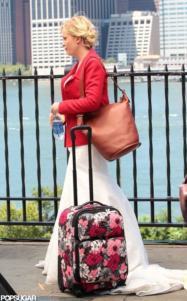 Amy Poehler carried a bright piece of luggage for a scene staged along the Hudson River.