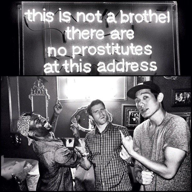 Bryan Greenberg hung out with some friends under a neon sign. Source: Instagram user bryangreenberg