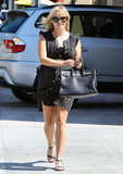 Reese Witherspoon wore a black dress to lunch in LA.