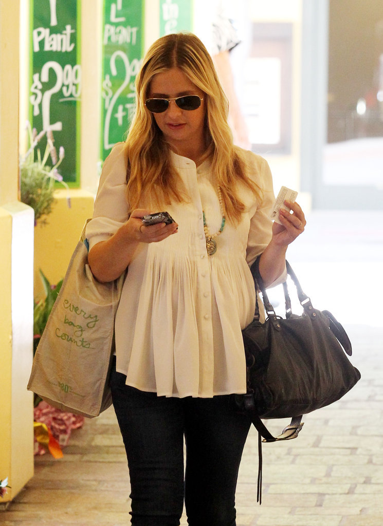 Sarah Michelle Gellar covered her baby bump in a white top.