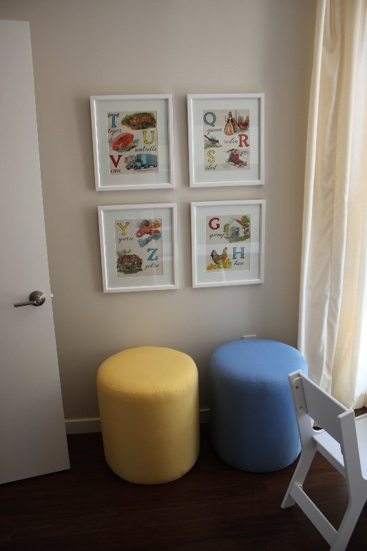 Vintage alphabet art was framed for the walls. The poufs are from Lee but are upholstered with kid-friendly Sunbrella fabric.