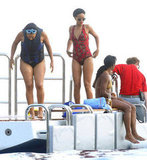 Rihanna Wears a Red Hot Suit on Vacation